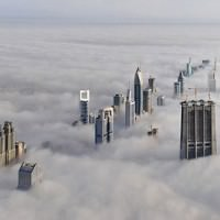 dubai_skyscrapper_clouds_top_bird